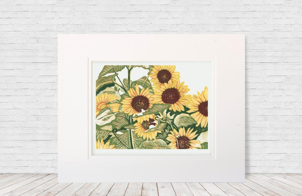 "Six-color 8""x10"" linoleum reduction block print of a patch of blooming sunflowers. Made in 2019."